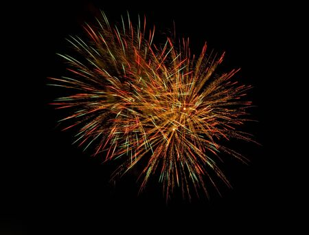 Centered image of exploding fireworks  can add more copy space in any direction due to it
