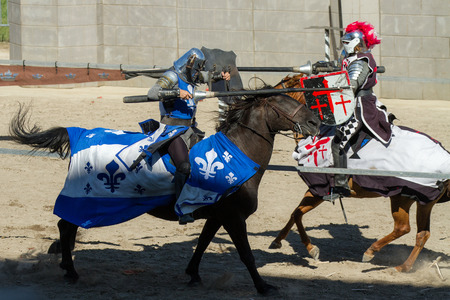 BOISE, IDAHO - AUGUST 19: Close call between the blue knight and the red knight while jousting at the Idaho Fair in Boise, Idaho on August 19, 2012