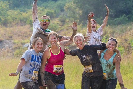 BOISE, IDAHOUSA - AUGUST 10: Group of people pose during the race at the The Dirty Dash in Boise, Idaho on August 10, 2013
