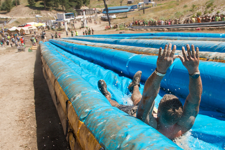 dirty feet: BOISE, IDAHOUSA - AUGUST 10: Person going feet first down the long slide at the The Dirty Dash in Boise, Idaho on August 10, 2013