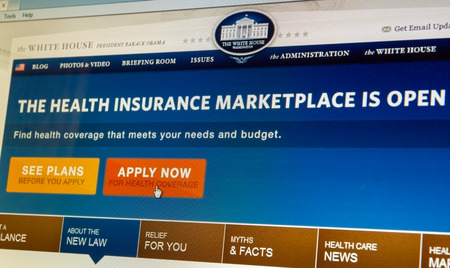 BOISE,IDAHOUSA - DECEMBER 21 2013: Whitehouse.gov displays information about the Affordable Healthcare Act and directs to healthcare.gov to apply