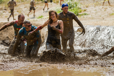 BOISE, IDAHOUSA - AUGUST 11, 2013:  Unidentified woman makes a final dash to the finish at the dirty dash