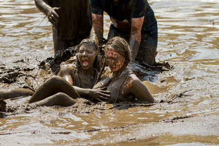 mud woman: BOISE, IDAHOUSA - AUGUST 11, 2013: Two unidentified woman after falling into the mud at the dirty dash Editorial