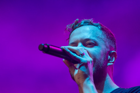 reynolds: BOISE, IDAHOUSA - FEBUARY 8, 2013: Close up of Dan Reynolds, the frontman for Imagine Dragons as he performs on stage