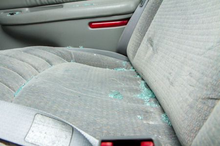 The glass could be from an auto accident, maybe a drunk driver, vandalism, or a car that was broken into photo