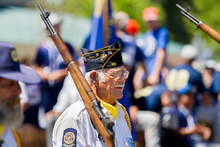 middleton: MIDDLETON, IDAHO - JULY 4: Pat Oatman of post 39 with the American legion on parade in Middleton, Idaho July 4th, 2012