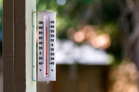 It's a warm day outside with the thermometer reacing above 100 degrees. Stock Photo - 26499366