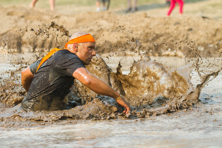 BOISE, IDAHOUSA - AUGUST 10: Unidentified participant runs while making a splash at the The Dirty Dash in Boise, Idaho on August 10, 2013