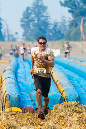 mud slide: BOISE, IDAHOUSA - AUGUST 10:Unidentified person runs off the hay at the The Dirty Dash in Boise, Idaho on August 10, 2013