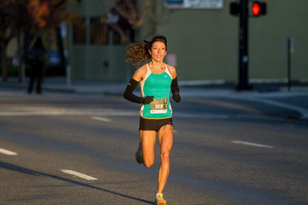 BOISE, IDAHO - NOVEMBER 22: Runner 928 runs to the finish line during the Turkey Day 5k in Boise, Idaho on November 22, 2012