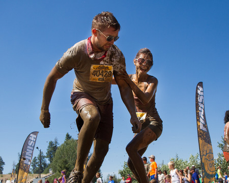 BOISE, IDAHOUSA - AUGUST 10: Two runners horse around as they cross the 10k run at the The Dirty Dash in Boise, Idaho on August 10, 2013 Editorial