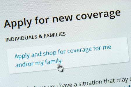 subsidy: BOISE,IDAHOUSA - DECEMBER 21 2013: Applying for coverage on the healthcare.gov website.