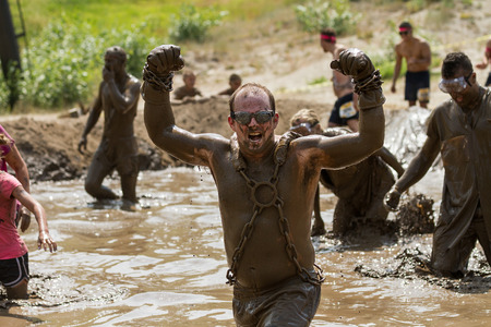 BOISE, IDAHOUSA - AUGUST 11, 2013: Unidentified man shows in strength at the dirty dash Editorial