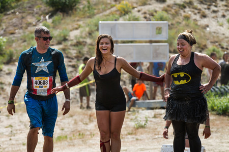BOISE, IDAHOUSA - AUGUST 11, 2013: Group of people pausing for a moment during the race at the dirty dash