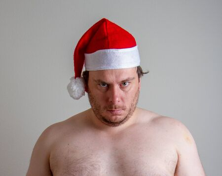 angry looking santa who is not wearing a shirt