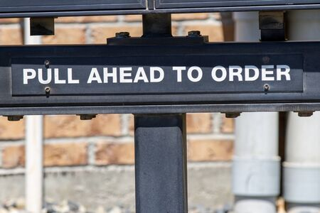 sign instructing people to pull forward to order