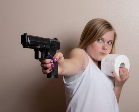Young girl protecting her toilet paper from theft Standard-Bild