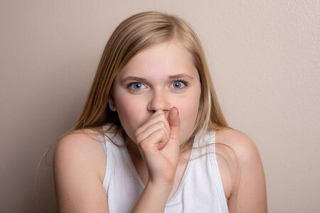 girl coughing into her hand while sick