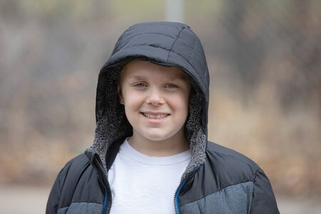 child wearing a coat in cool weather