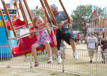 BOISE, IDAHO - AUGUST 23, 2012: Young girl on a swing during the Western Idaho Fair