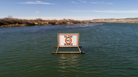 Sign telling people to produce no wake Stock fotó