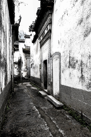 Narrow alley in between houses