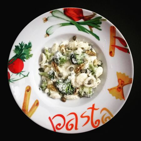 Pasta with broccoli in cheese sauce