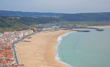 promontory: Beach panoramic view from the promontory in Nazare, Portugal Stock Photo