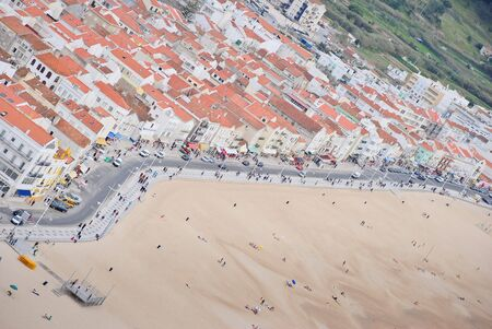 Beach panoramic view from the promontory in Nazare, Portugal photo