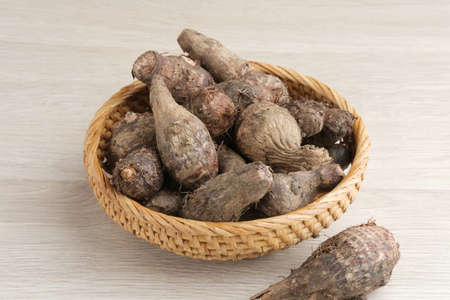 Taro, Talas belitung, kimpul or bentul, are starchy tubers that can be eaten. Served boiled or steamed. Stock Photo