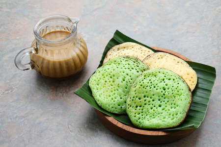 Serabi or Surabi, Indonesian pancake made of flour, rice flour and coconut milk. Served with palm sugar sauce. Sweet and savory. Reklamní fotografie