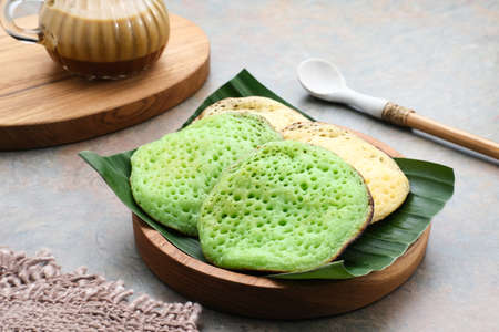 Serabi or Surabi, Indonesian pancake made of flour, rice flour and coconut milk. Served with palm sugar sauce. Sweet and savory.