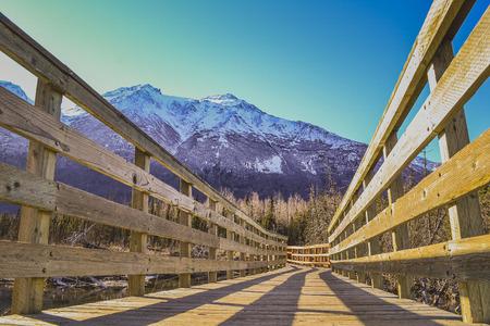 footbridge in the Alaska mountain Stock Photo