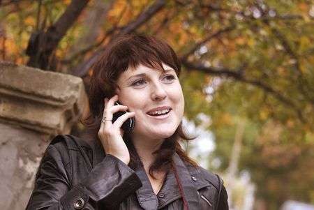 communicates: The woman communicates by phone