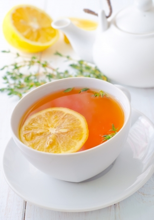 Fresh tea with lemon in the white cup Stock Photo
