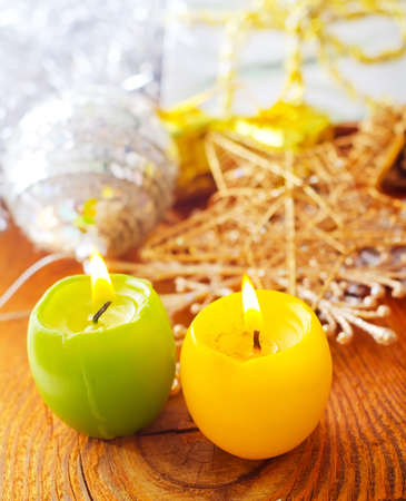 two candles, yellow and green candles, cristmas decoration photo