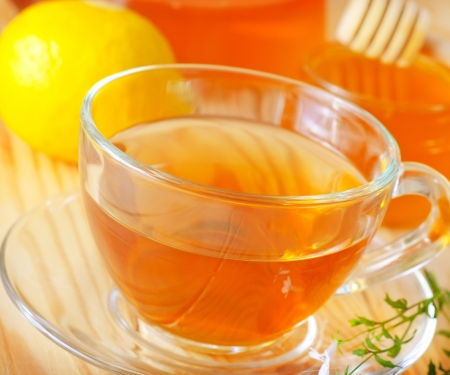 Fresh tea with lemon in the glass cup photo