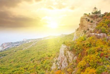 The church in Crimea mountain, sunset in the mountain