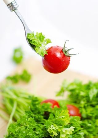 Fresh tomato cherri and green salad Stock Photo