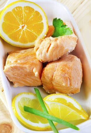 Baked salmon with lemon on the white plate Stock Photo - 16395607