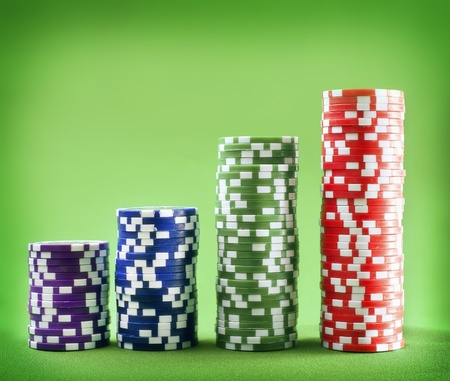 Chips for poker on the green background photo
