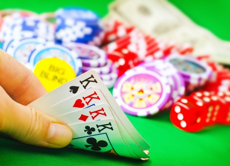 casino table: Card for poker in the hand, chips and card for poker