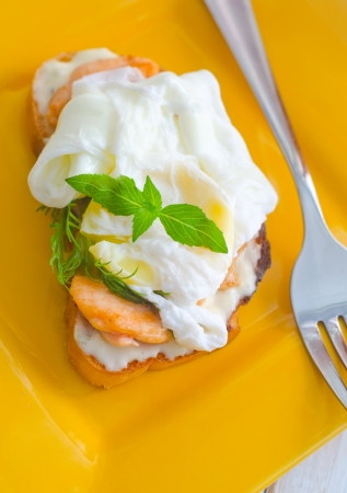 Close Up of Poached Delicious Egg with Whole Grain Bread photo