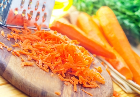 raw carrots and knife on the wooden board photo