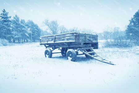 an old farm cart in the snow photo