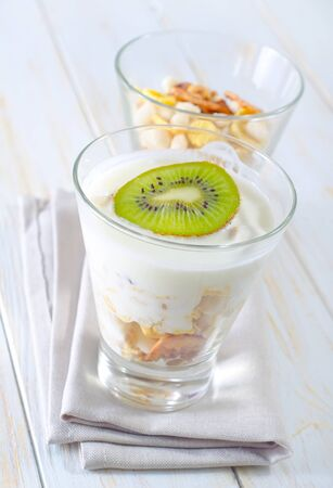 fresh yogurt and muesli in a glass photo