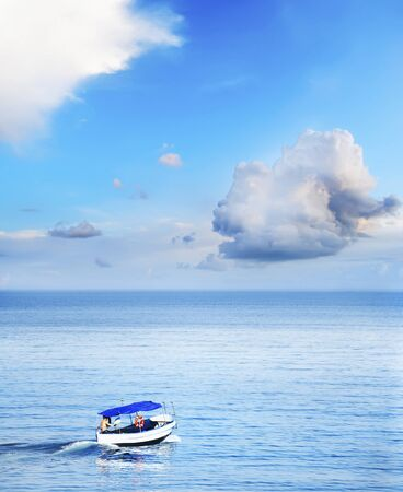 poetic: boat on the sea