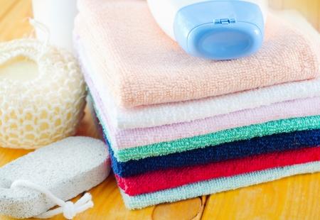 shampoo, body wash and towels photo