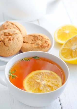 salubrious: Fresh tea with lemon in the white cup Stock Photo
