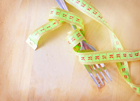 wooden metre: metr and fork on the wooden board